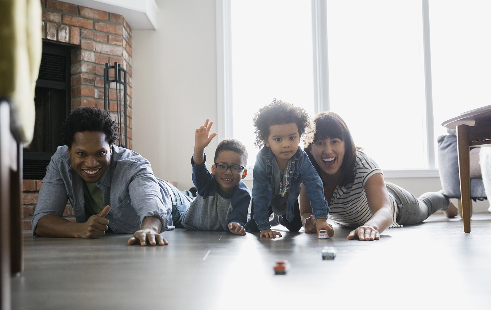 Family playing on wood floor