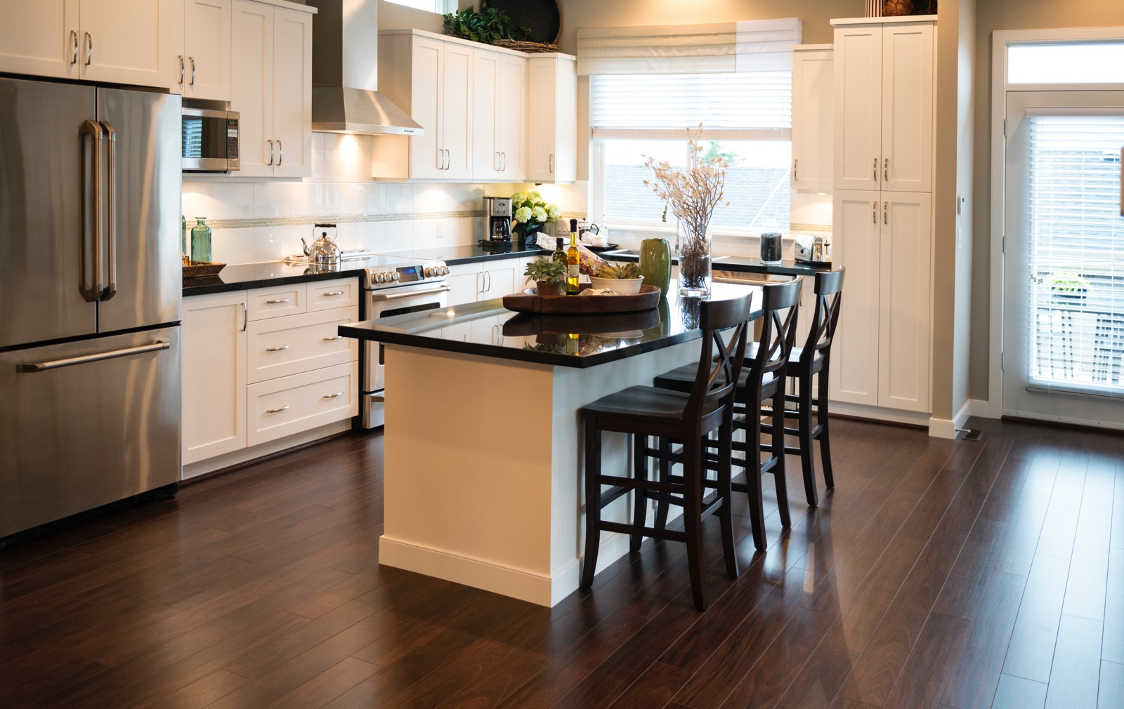 Kitchen with wooden floors and island counter