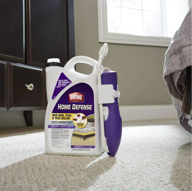 Ortho® Home Defense® Bed Bug, Flea & Tick Killer sitting on the ground in front of a dresser and bed